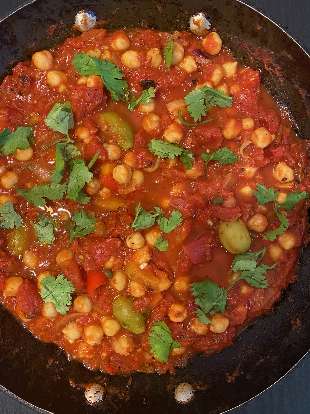 Chickpeas simmered in tomatoes.