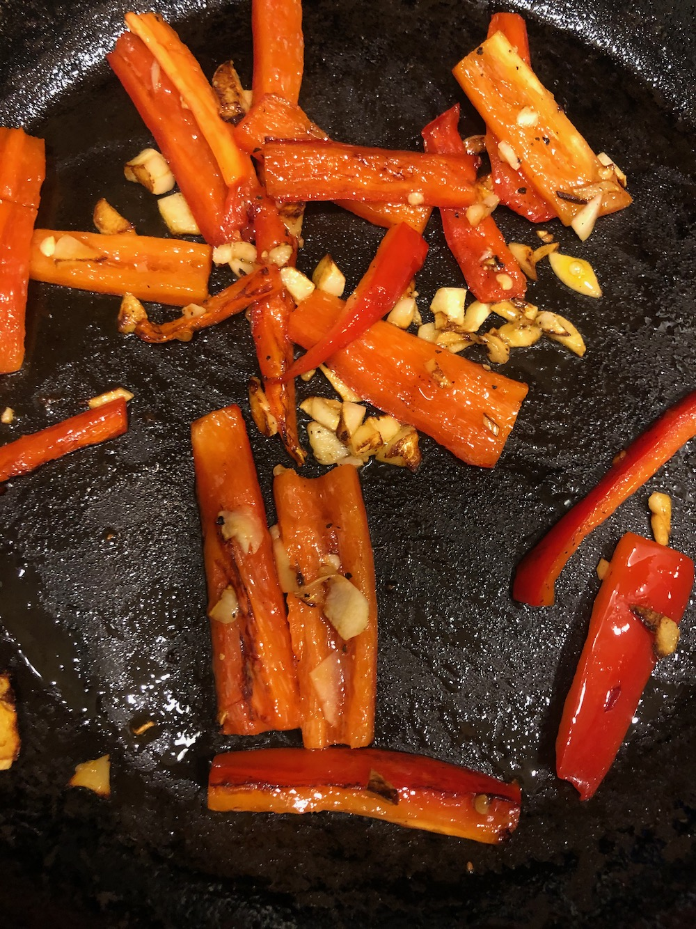 Sautéing the red pepper with garlic.